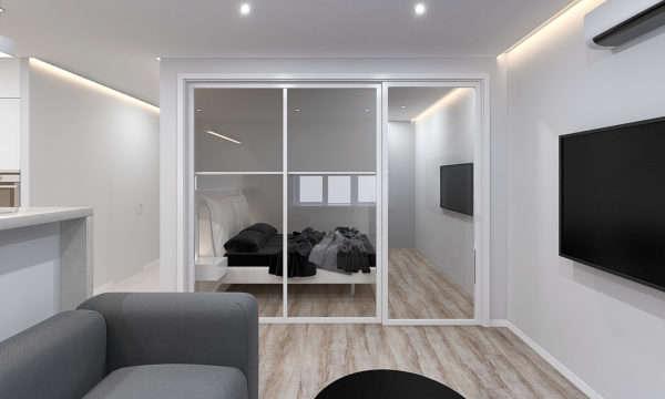 вид на перегородку стеклянную с раздвижной дверью в спальню в однокомнатной квартире 44 квадратных метра